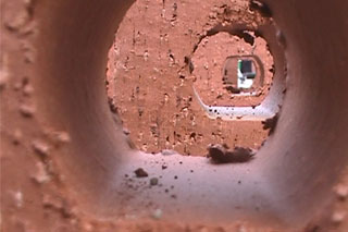 Fresh Page - installation view [close-up bricks] new library building site, Leeds. CiCi Blumstein 2001.